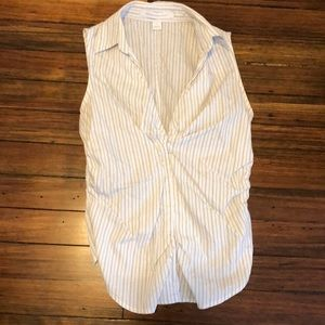 Women's sleeveless button up top. Size S
